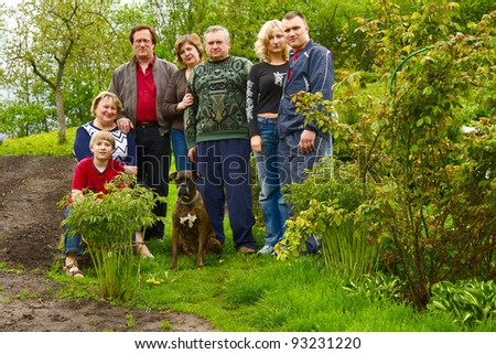 Happy, Attractive Family Pose for a Portrait Outdoors #93231220