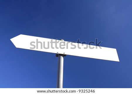 blank white direction board with blue sky in the background
