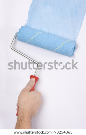 house painter using a paint roller, painting a wall in motion #93254365