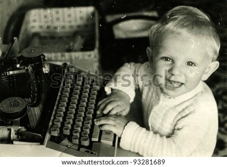 toddler played with a typewriter, Kursk, USSR, 1983 (very grainy image)