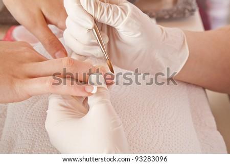 nail designer working on acrylic toenails #93283096