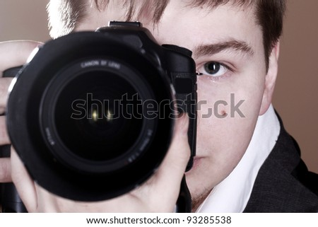 Photographer with camera in studio #93285538