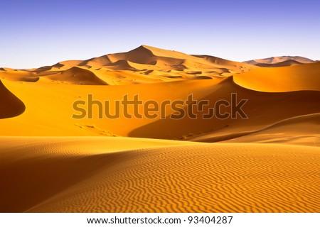 Moroccan desert landscape with blue sky. Dunes background. #93404287