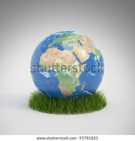 Earth globe growing in a patch of grass - ecology concept #93781825