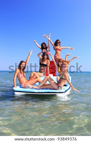 Group of six beautiful young women on a pedalo boat #93849376