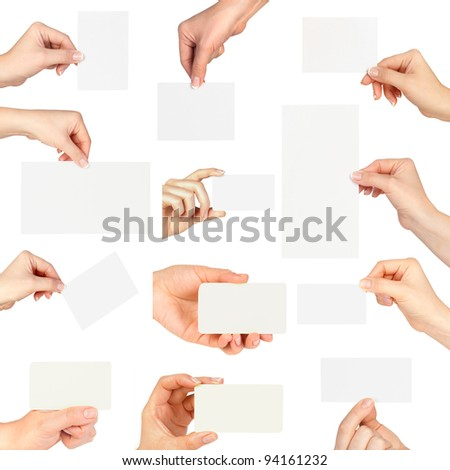 Collection of business card blanks in a hand on white background