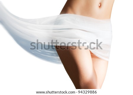 Beautiful woman with white tissue on her hips melting in red liquid