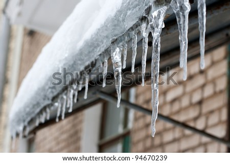 icicles which are hanging down from a roof Royalty-Free Stock Photo #94670239