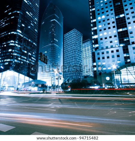 the light trails on the modern building background in shanghai china. #94715482