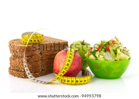 Healthy food for diet as bread fruit and vegetables with measurement tape #94993798