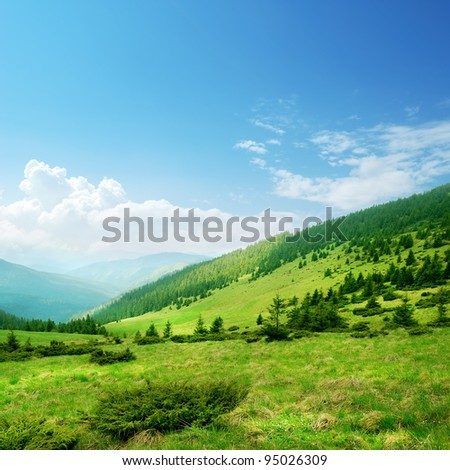 Blue sky and green hills. Summer mountain landscape #95026309