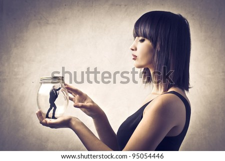 Woman holding a pot with imprisoned man in it #95054446