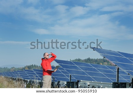 business man  engineer using laptop at solar panels plant eco energy field  in background #95055910