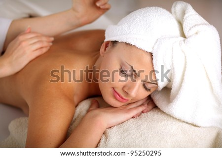 Girl on a stone therapy, hot stone massage. Isolated on white. #95250295