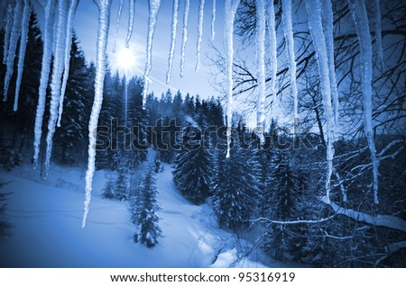 view of the winter landscape through the ice icicles Royalty-Free Stock Photo #95316919