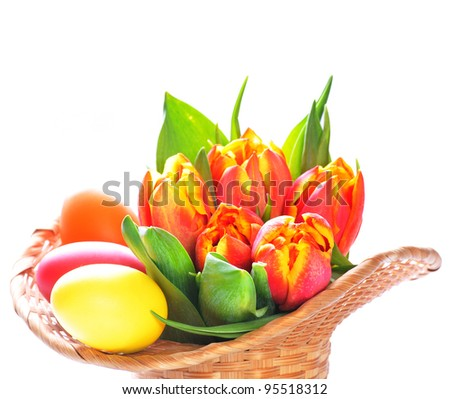 Image of decorative Easter eggs and tulips in basket #95518312
