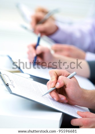 Close-up of business human hands writing in paper #95596681