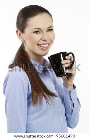 Young smiling woman holding a cup of tea #95601490