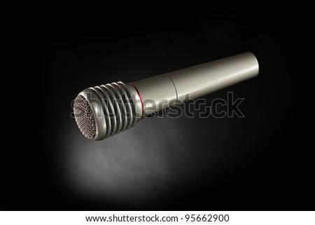 Shiny grey iron microphone on black background #95662900