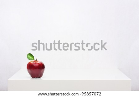 Red apple on the white shelf #95857072