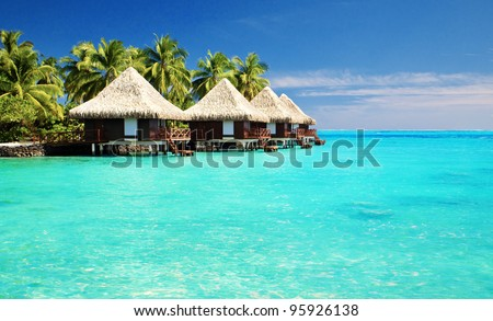 Over water bungalows with steps into amazing green lagoon #95926138