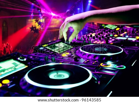 Dj mixes the track in nightclub at party Royalty-Free Stock Photo #96143585