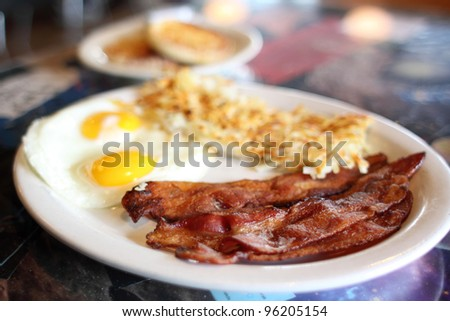 Breakfast of eggs, bacon, and hash brown at a diner. #96205154