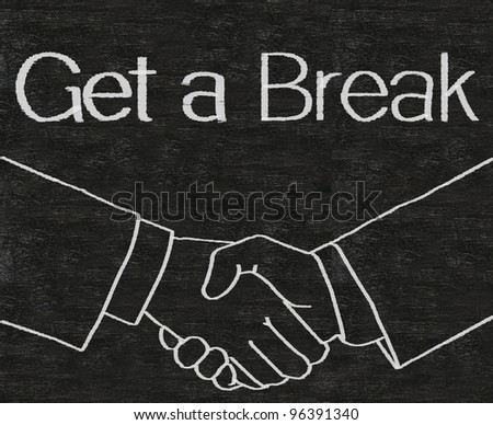 business idioms written on blackboard with shake hands, get a break #96391340