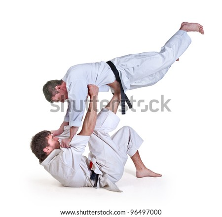 battle throw.Judo.figure in the karate fighting stance on a white background.masters of hand-to-hand fight #96497000