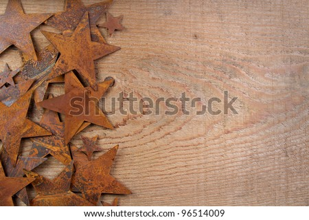 Rusty stars on a wooden background, room for copy space