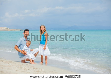 Young father with her two kids on tropical beach vacation #96553735