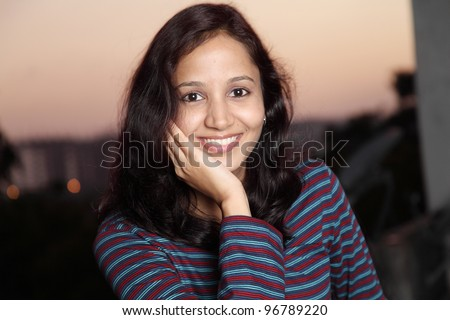 Portrait of happy young Indian woman #96789220