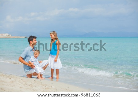 Young father with her two kids on tropical beach vacation #96811063
