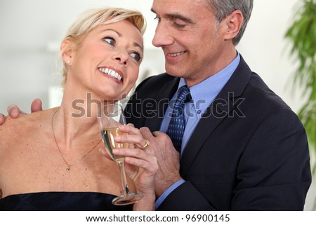 A middle age couple celebrating. #96900145