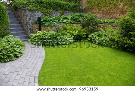 Garden stone path with grass growing up between the stones #96953159