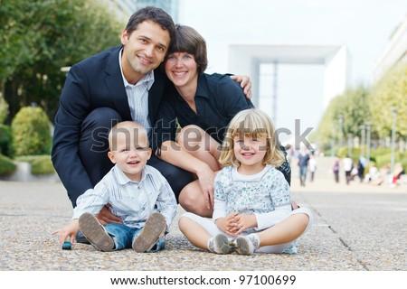 Happy family of four walking to la Defense, Paris. #97100699