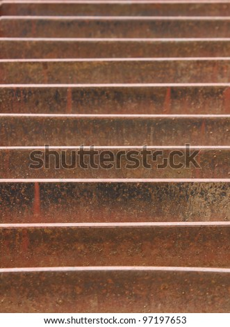 Abstract view of rusted metal storm drain on street #97197653