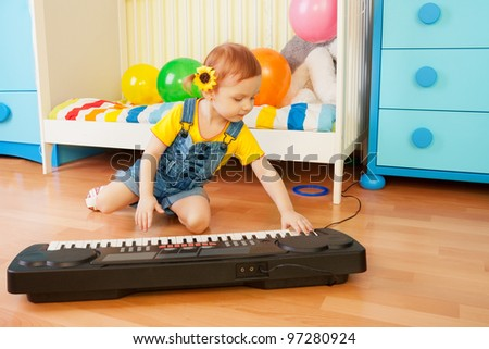 Girl playing piano sitting on the floor in bedroom #97280924