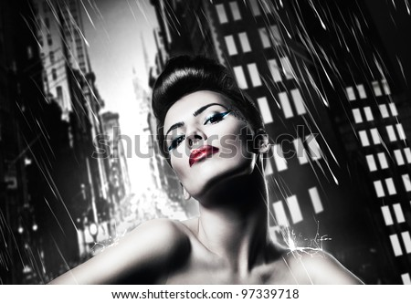 attractive brunette woman with red lips in rainy city #97339718
