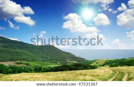 Summer day landscape with the sea and mountains. #97531367