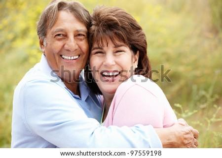 Senior Hispanic couple outdoors #97559198