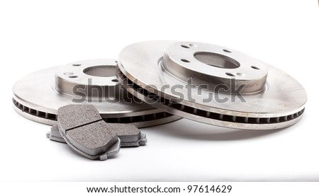 New front brake disks and pads for a modern car Royalty-Free Stock Photo #97614629