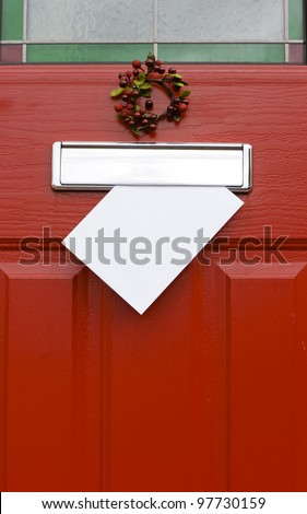 Red front door with mail (post) box and a white letter (envelope). Christmas mail concept. Space for your text. #97730159