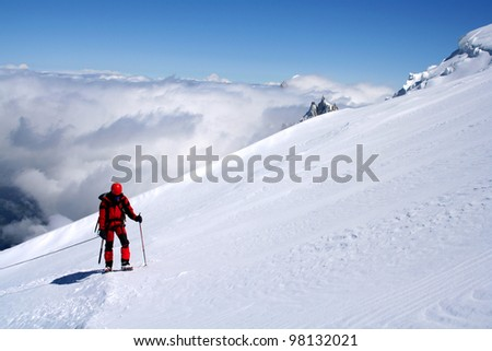 Mountaineer climbing Mont Blanc in French Alps, France. #98132021