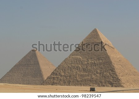 two of the three great pyramids at Giza Egypt sit side by side through the centuries. #98239547