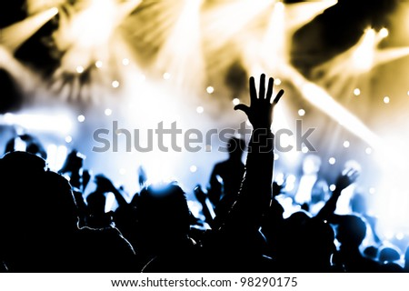 crowd cheering and hands raised at a live music concert #98290175