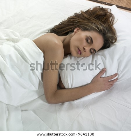 studio portrait isolated on white background of a beautiful caucasian woman sleeping #9841138