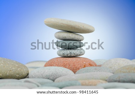 Pebbles stack against gradient background #98411645