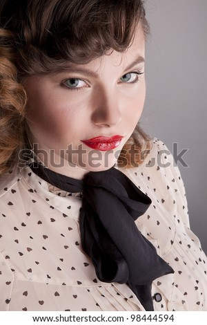 The girl the brown-haired woman with a black bow-tie poses in studio #98444594