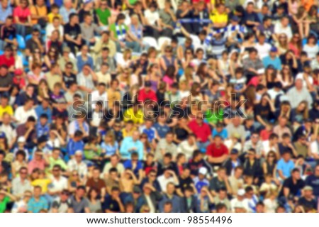 Blurred crowd of spectators on a stadium tribune at a sporting event #98554496